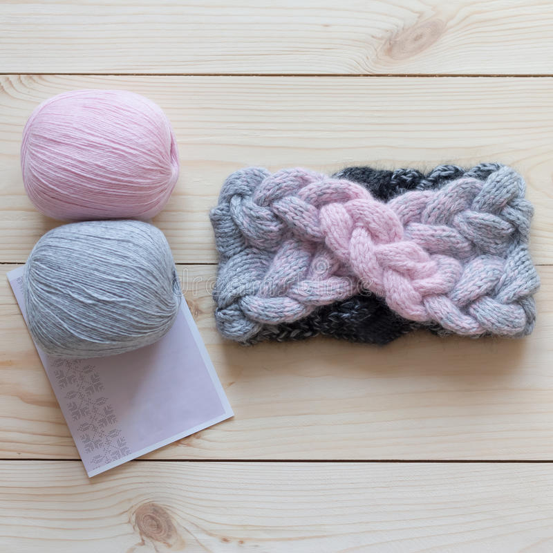Two skeins of wool and knitted headband stock photo