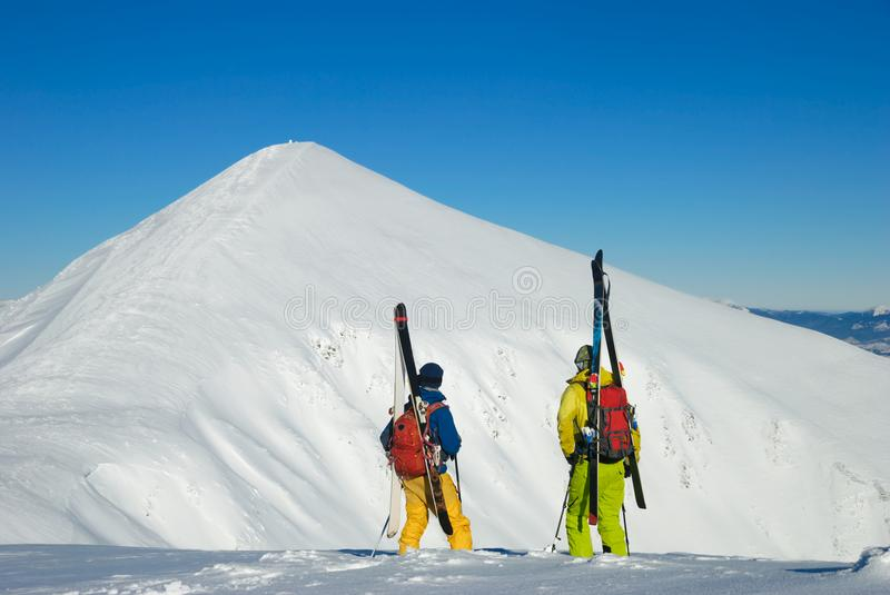 Skiers before downhill on a freeride slope look at a beautiful p stock photography