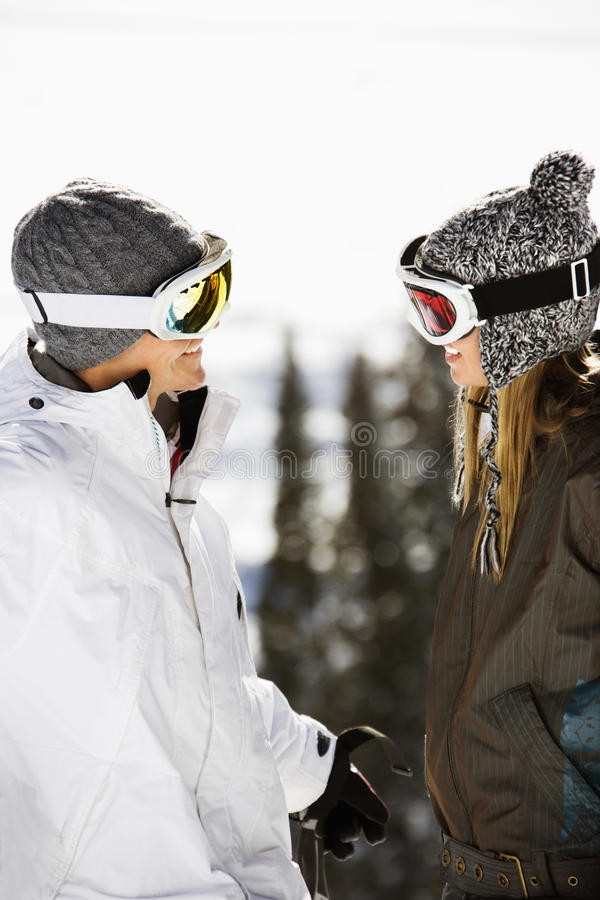 Two Skiers Smiling at Each Other