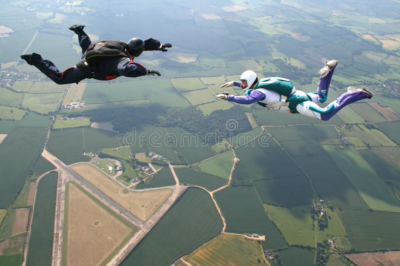 Two skydivers in freefall stock photography