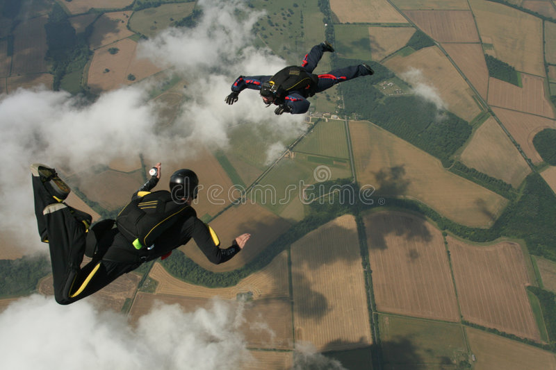 Two skydivers performaing formations