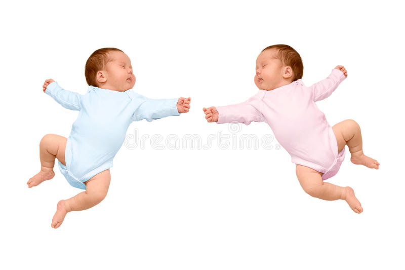 Two sleeping newborn baby identical twins. A boy and girl, brother and sister. One kid wearing a pink body, a second baby in a blue body, ready for your logo royalty free stock image