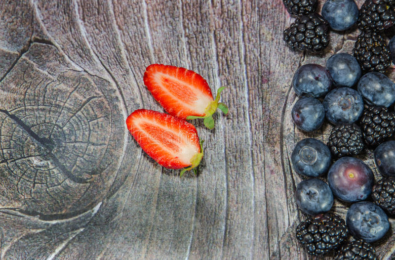 Download Two Sliced Strawberries On Wood Stock Photography - Image: 30427662