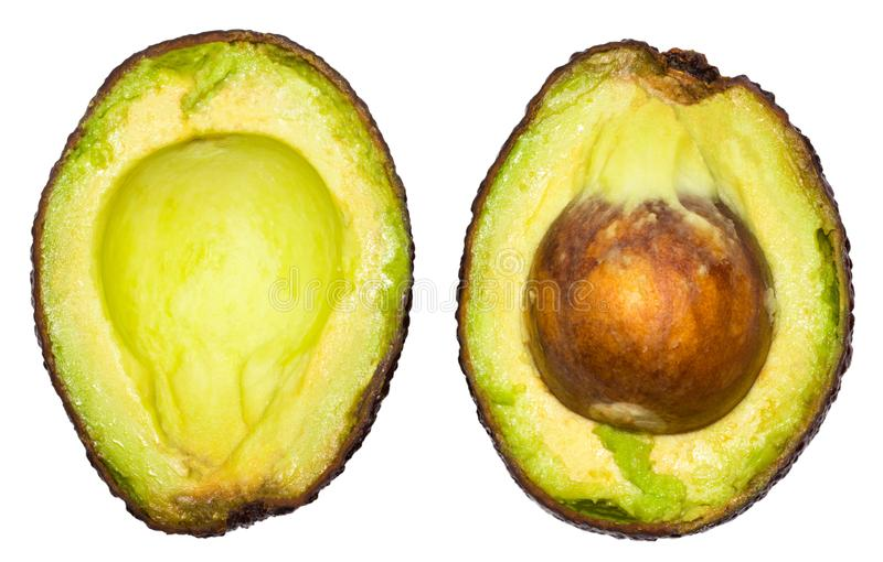Two slices of avocado isolated on the white background. One slice with core. Design element for product label.  stock photo