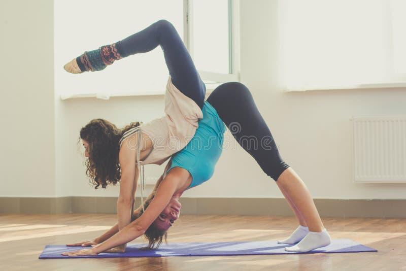 Two Slim Girls Are Doing Yoga Indoors Stock Photo - Image ...