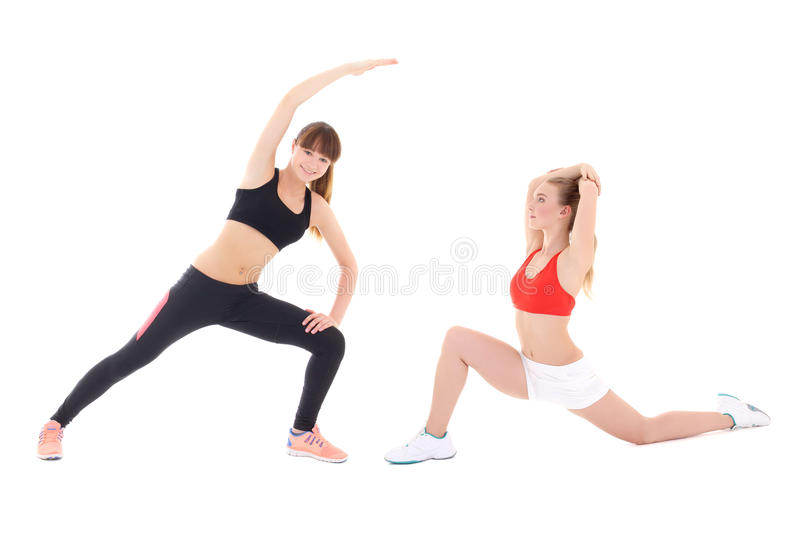 two slim sporty women doing stretching exercises isolated on white royalty free stock photography