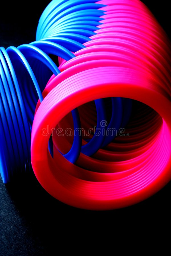 Download Two Slinkies stock photo. Image of bounce, interlock, pink - 653948