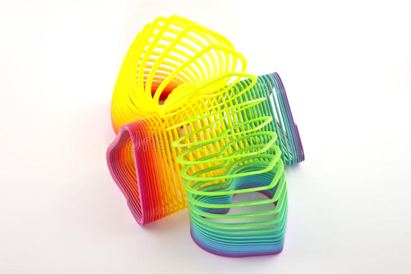 Two slinky toys. One slinky jumping over another royalty free stock photo
