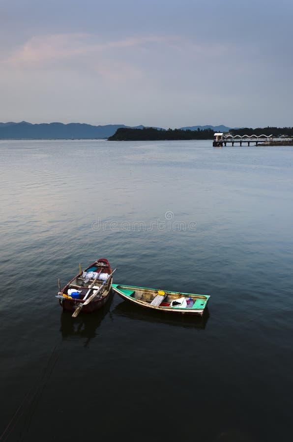 Two Small Boats and Public Pier in Calm Sea