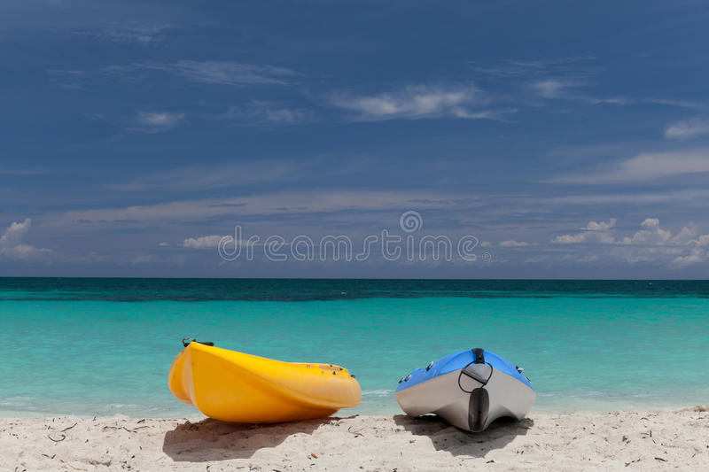 Two small boats stay on the sea front royalty free stock photography