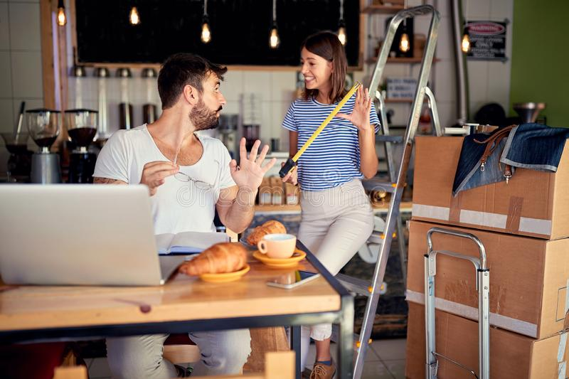 Two small business owner ready to open their cafe royalty free stock photos