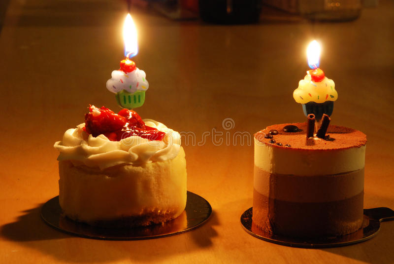 Two Small cakes with candles stock photography