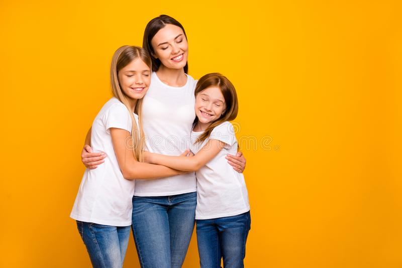 two beautiful sisters hugging isolated stock photos
