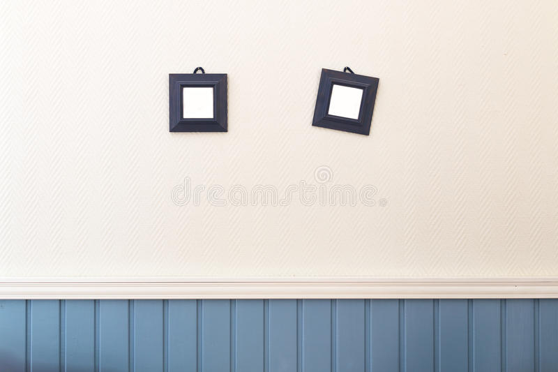 Two Small Square Frames Hanging On The White And Blue Wall. Stock ...