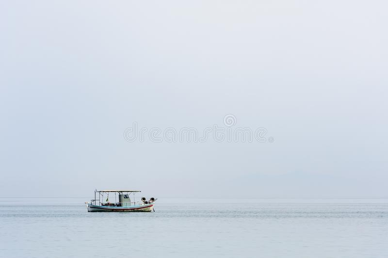 Two small fishing boat at sea surface royalty free stock photos