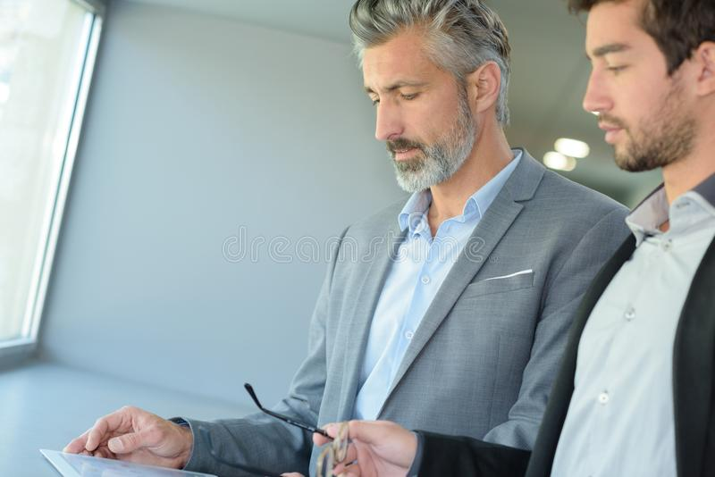 Two smart business managers in discussion stock photo