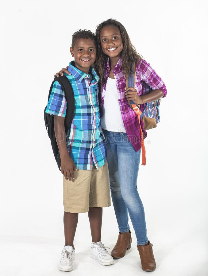Two smiling African American schoolkids isolated on a white background stock image