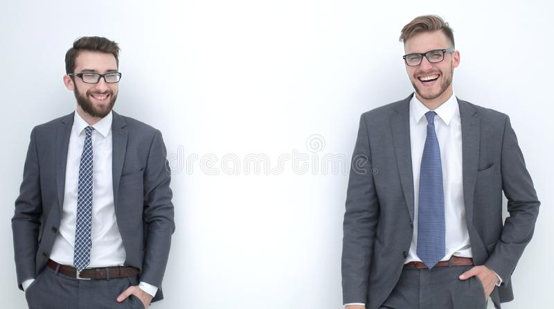 Two smiling businessmen isolated in the light royalty free stock image