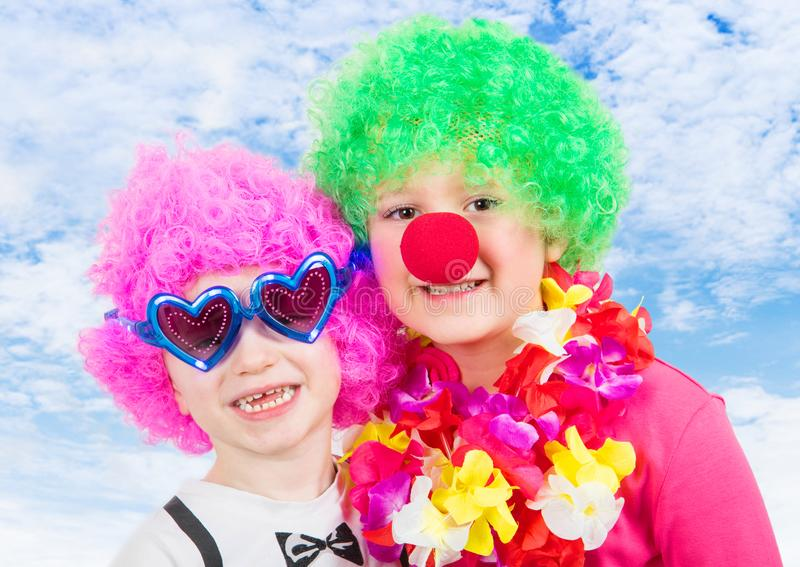 Two smiling child with carnival mask royalty free stock photos