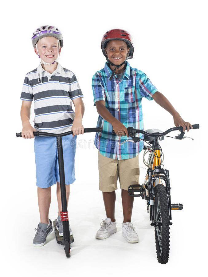 Two smiling diverse schoolkids isolated on a white background stock photography