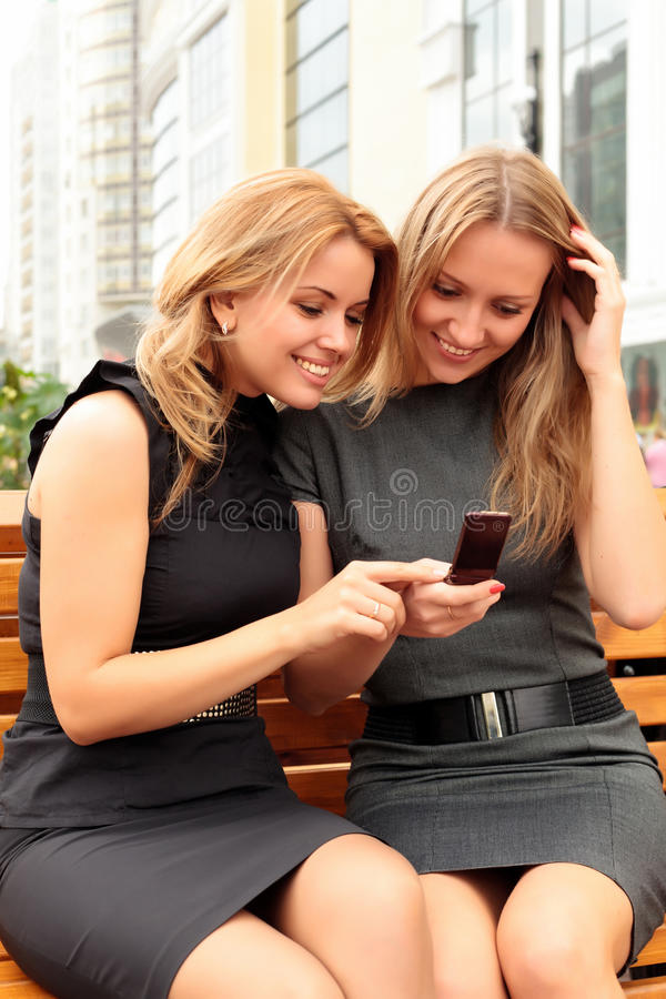 Two smiling girls royalty free stock photo