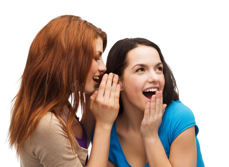 Two Smiling Girls Whispering Gossip Royalty Free Stock Photo