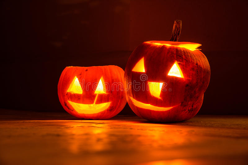 Two smiling halloween pumpkins at night royalty free stock image