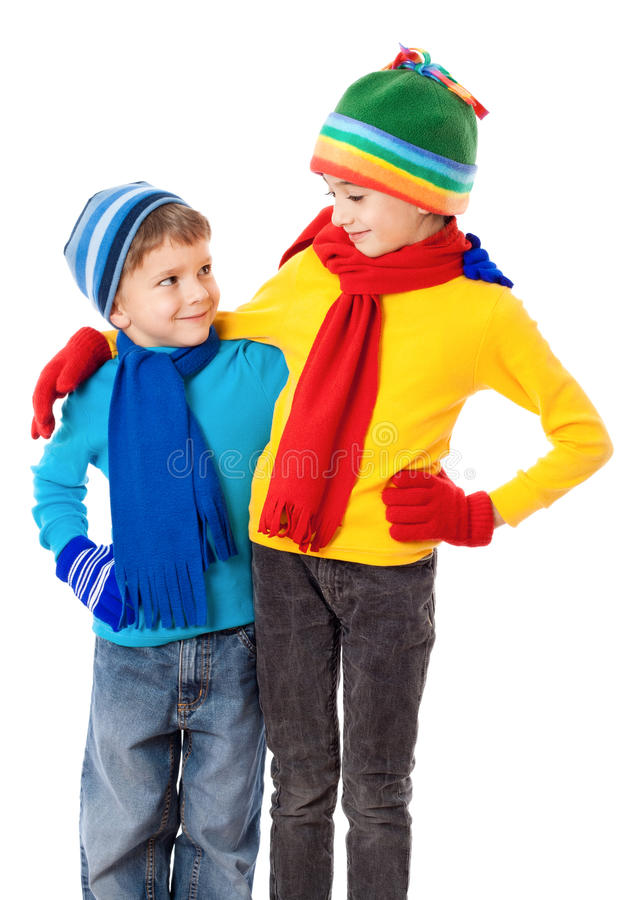 Two smiling kids in winter clothes