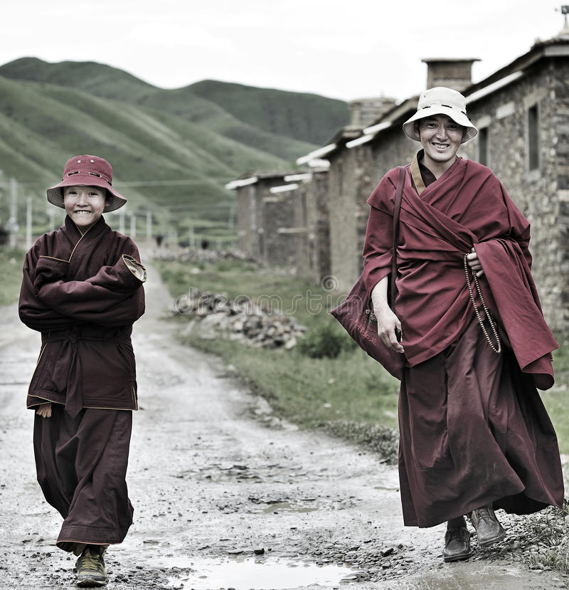 Two smiling monks royalty free stock image