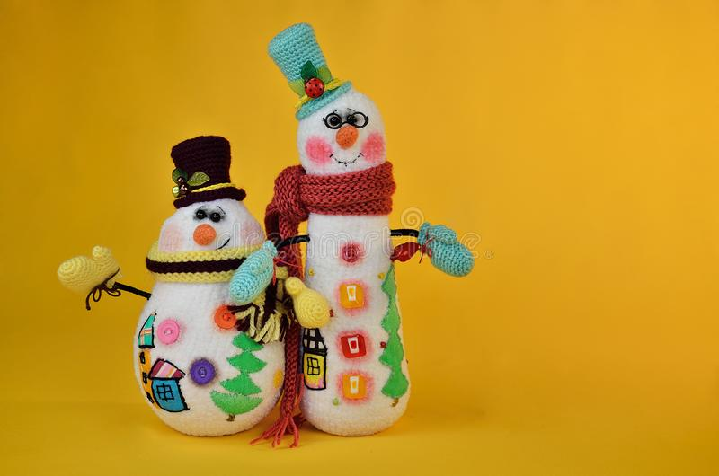 Two smiling snowmen toys, fat and tall stock photography