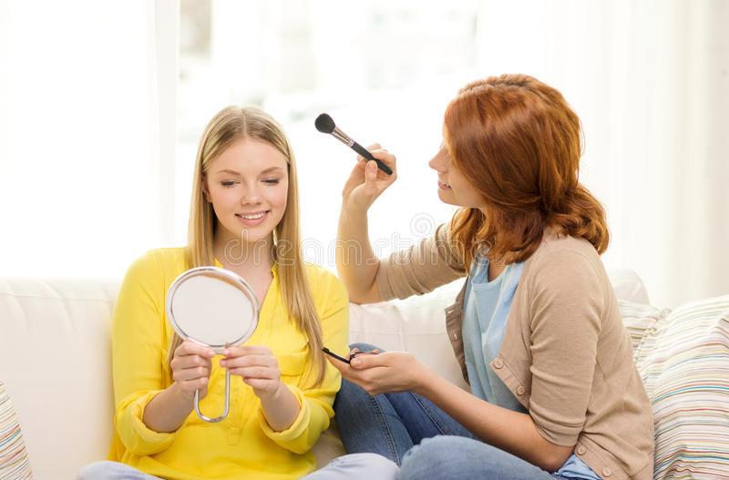 Download Two Smiling Teenage Girls Applying Make Up At Home Stock Image - Image: 42706671