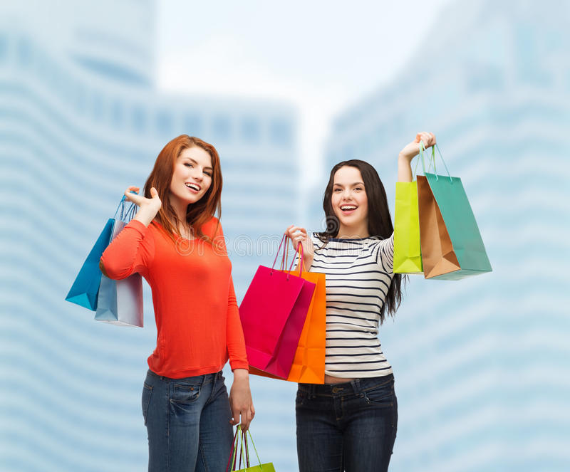 Download Two Smiling Teenage Girls With Shopping Bags Stock Photography - Image: 36591842
