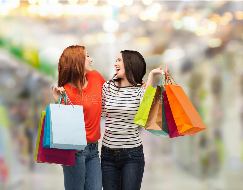 Download Two Smiling Teenage Girls With Shopping Bags Stock Image - Image: 36702849