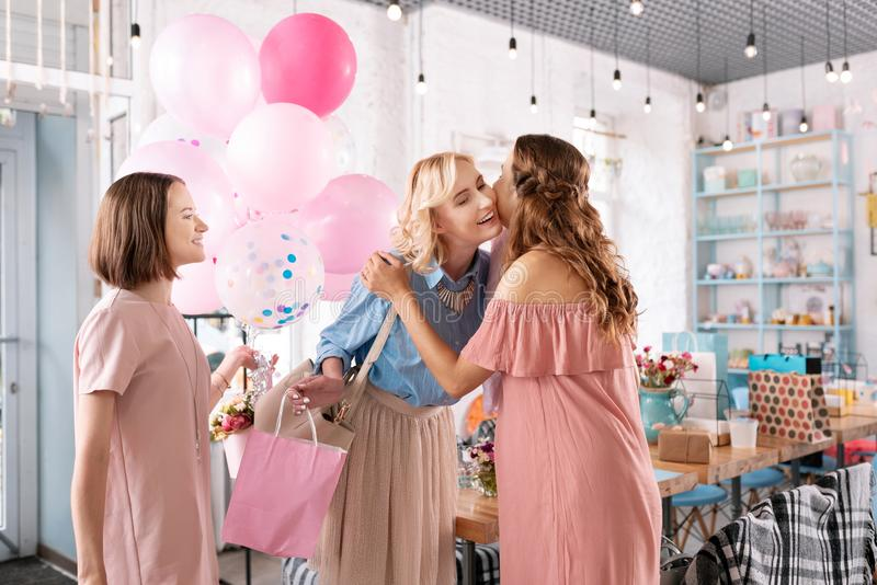 Two smiling women coming to event agency while planning baby shower. Event agency. Two smiling women coming to event agency while planning baby shower stock photos