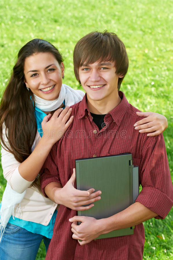 Download Two Smiling Young Students Outdoors Stock Image - Image: 21343735
