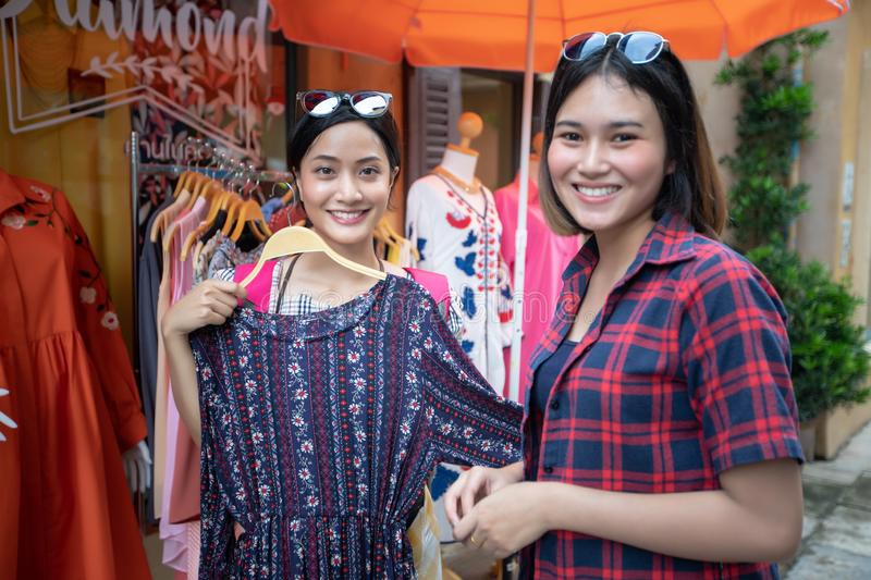 Two smiling young woman Asian with shopping and buy at outdoor m royalty free stock photo