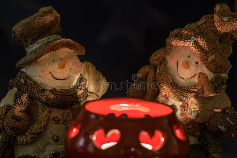 Two snowman and candle. stock image
