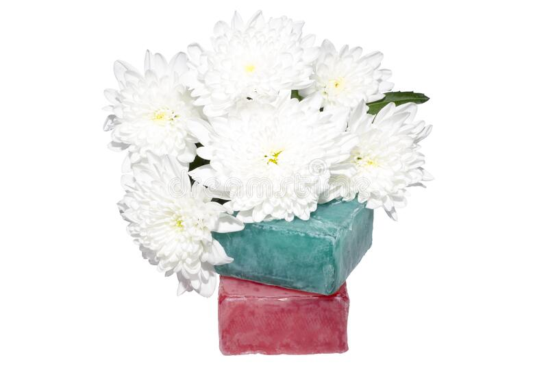 Two soaps and a bunch of flowers stock photography
