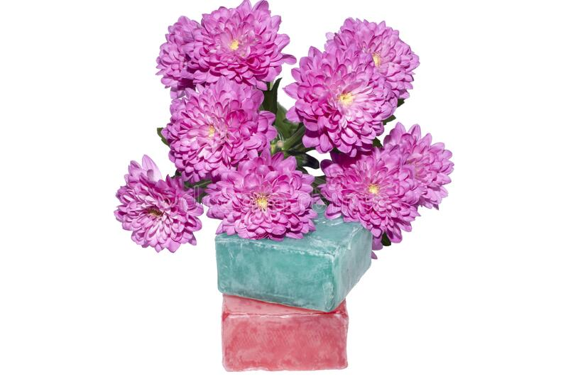 Two soaps and a bunch of pink flowers stock photos