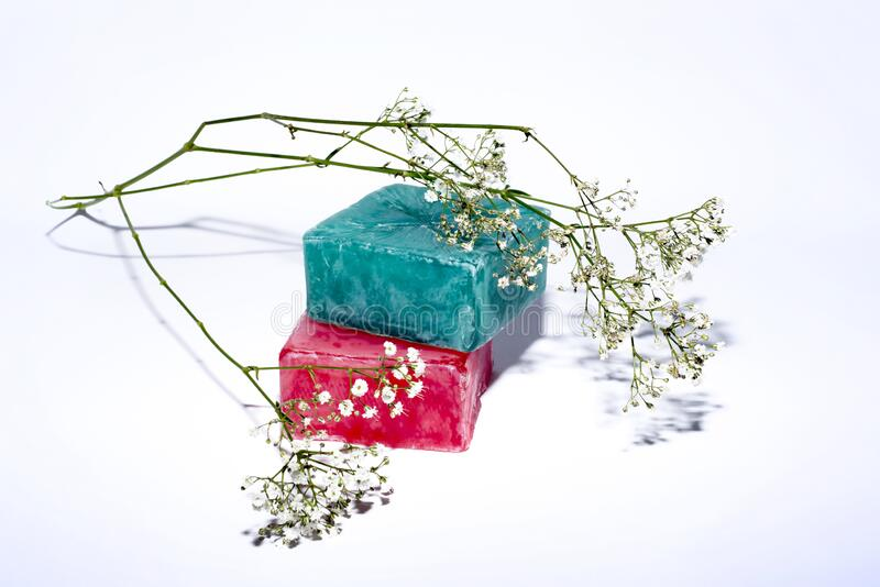Two soaps and little flowers royalty free stock photos