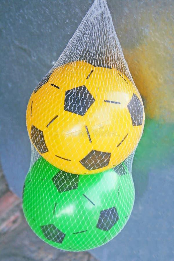 Two soccer balls in a mesh bag stock photos