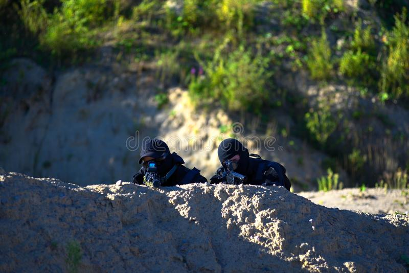 Two soldiers in action royalty free stock images