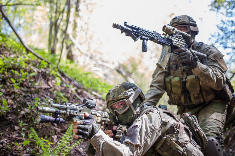 Two soldiers aim at target. With automatic weapons royalty free stock images