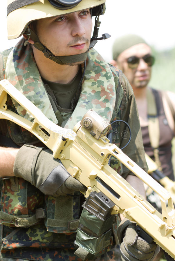 Two soldiers in full ammo outdoors stock photography