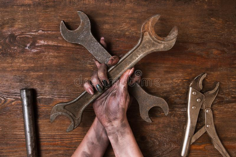 Two spanners wooden background service maintenance royalty free stock photo