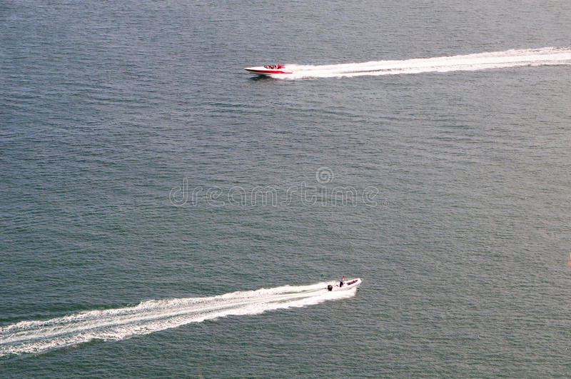 Two Speed Boats Passing stock images