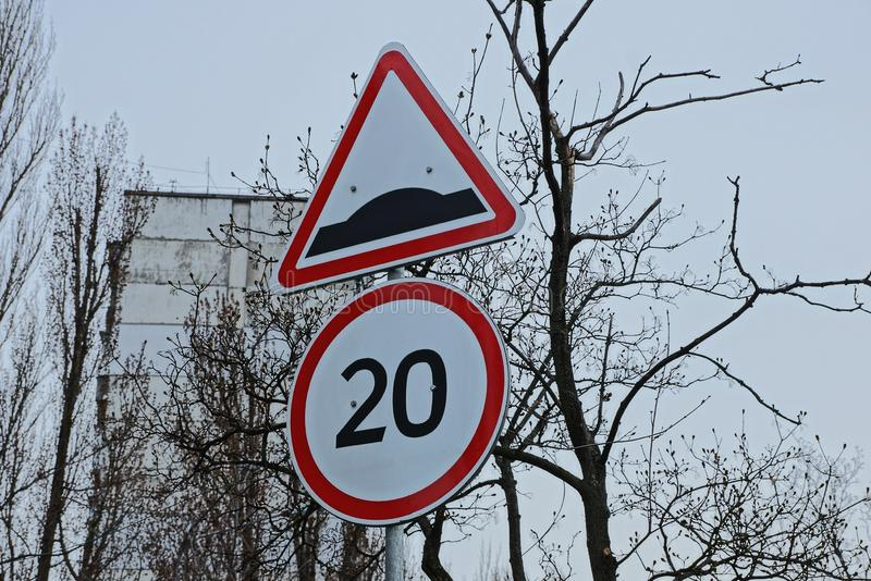 Two speed limit signs on the street by the road. Two speed limit signs on a pole on a street by the road stock photo