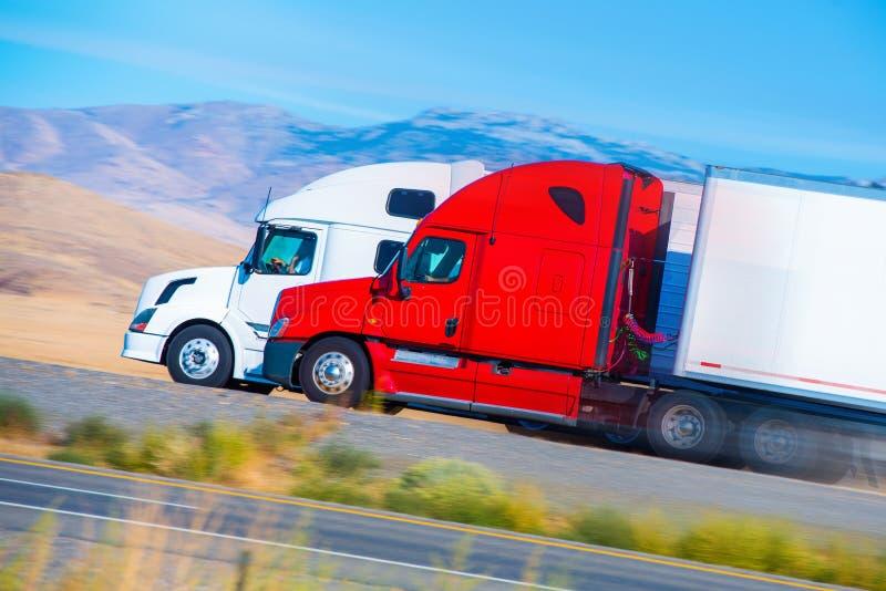 Two Speeding Semi Trucks royalty free stock photos
