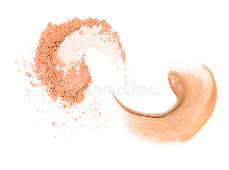Two spiral beige sample of foundation and powder isolated on white background. royalty free stock photo
