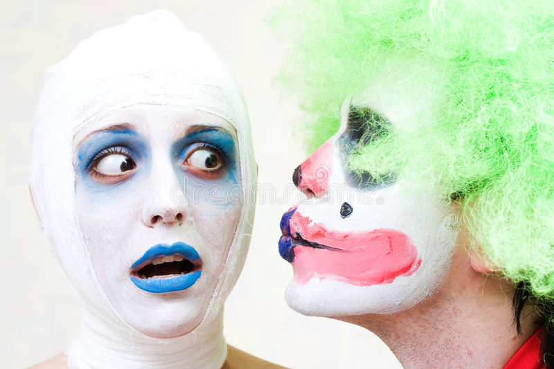 Two spooky clowns. In heavy make-up stock photo